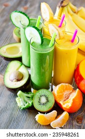 Healthy drink with fruits and vegetables on wooden table