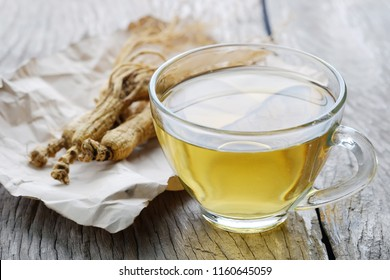 Healthy drink Ginseng tea on a wooden table.natural medicine.