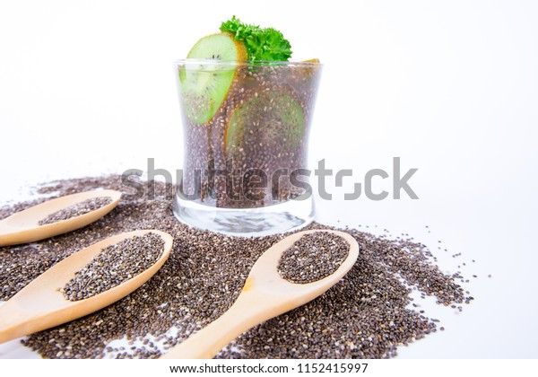 healthy drink in glass with chia seeds, kiwi and lemon juice on white background