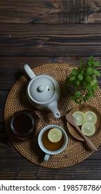 Healthy drink - lemon tea, grey background and rattan