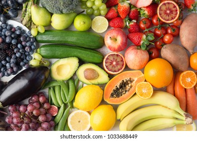 Healthy eating, assortment of fruits and vegetables in rainbow colours background, top view, selective focus