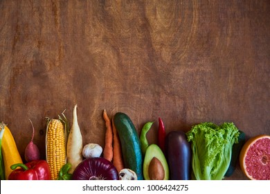 Healthy eating background. Food photography different fruits and vegetables on rustic wooden background. Copy space.