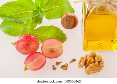 Healthy eating for beauty and energy! Grapes, mint leaves, natural oil and nuts