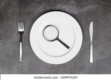 Healthy eating concept. Empty plate, cutlery and magnifying glass