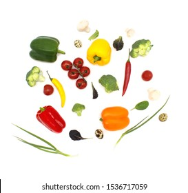 Healthy eating and cooking with various flying vegetables ingredients, isolated on white background, top view. Concept diet and healthy eating.