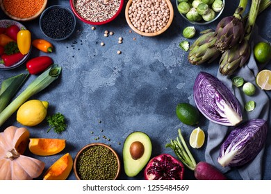 Healthy eating, copy space food background, fresh vegetables und legumes, clean eating concept, flat lay
