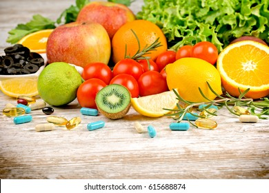 Healthy eating (diet) and healthy lifestyle with fresh organic fruit, vegetable and supplement (additive in healthy eating, diet)