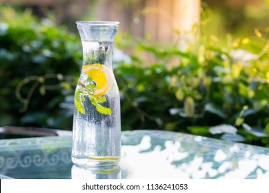 healthy eating, drinks, diet, detox with fruit water in glass bottle with lime and mint