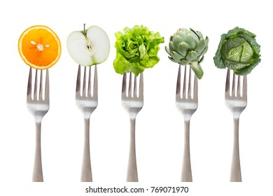 healthy eating: five iron fork with fruit and vegetable, on white background