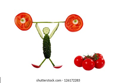 Healthy eating. Funny little man of the cucumber slices raises tomato bar.