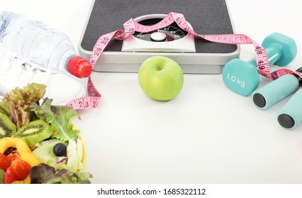 Healthy eating  green apple -weight scale with Workout and fitness dieting ,fitness  on white background ,weight loss concept