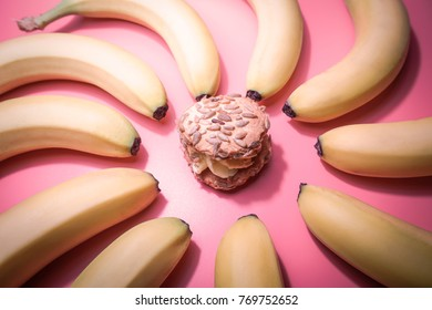 Healthy eating habits concept .Oat cookie and bananas on pink table.Top view.