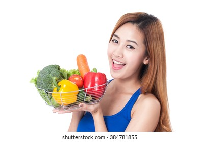 Healthy eating, happy young woman with vegetables on white background