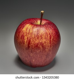 Healthy Eating - High Definition Studio Photo of a Fresh Organic Juicy Red Apple on Neutral Gray Background