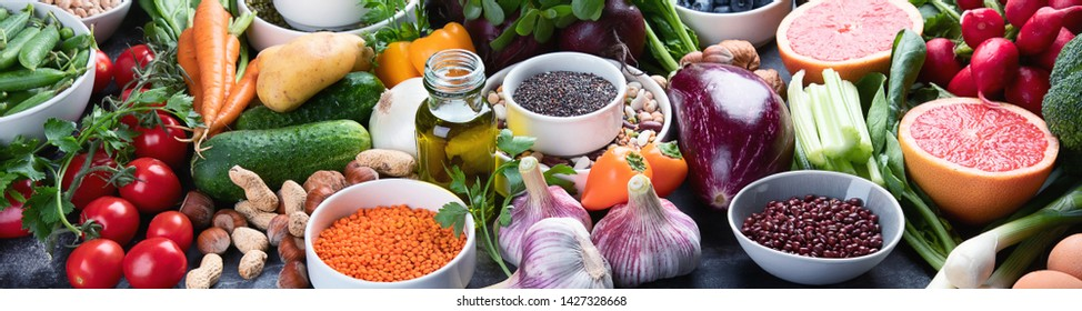 Healthy eating ingredients: vegetables, fruits and legumes. Nutrition, diet, clean food concept. Panorama, banner