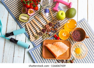 Healthy eating of ketogenic diet meal plan with Workout and fitness dieting ,fitness and weight loss concept, fruit, Vegetable and orange juice,top view on wooden background,Food and health.