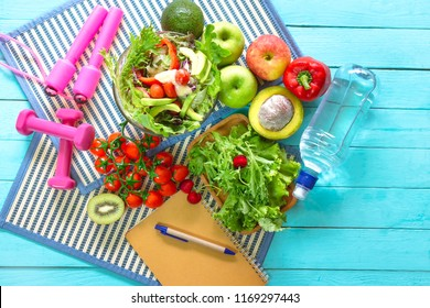 Healthy eating of ketogenic diet meal plan with Workout and fitness dieting ,fitness and weight loss concept, fruit, Vegetable and notebook,top view on wooden background,Food and health