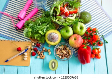 Healthy eating of ketogenic diet meal plan with Workout and fitness dieting ,fitness and weight loss concept, fruit, Vegetable and orange juice,top view on wooden background,Food and health