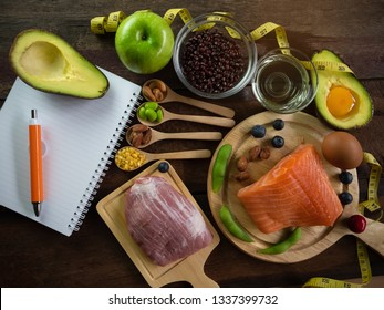 Healthy eating of ketogenic diet meal plan  apple,salmon and avocado with Workout and fitness dieting ,fitness and weight loss concept on wooden background