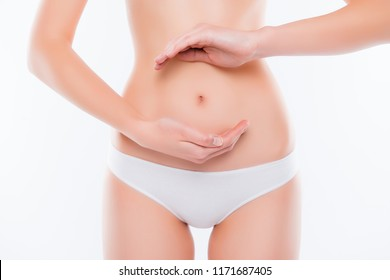 Healthy eating lifestyle nutrition concept. Cropped close up photo of skinny thin slim with flawless skin woman's belly,  demonstrating gesturing balance in microflora isolated on white background