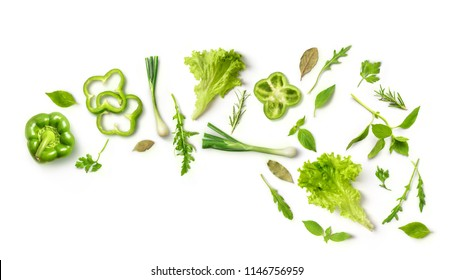 Healthy eating. Vegetables green peppers, onions, arugula, salad, on white background. Photo studio. Healthy food, top view. High Resolution Product
