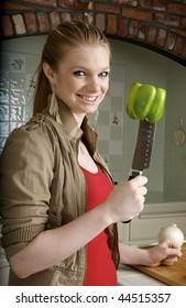healthy eating, woman with green pepper on knife