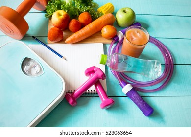 Healthy eating ,Workout and fitness dieting ,fitness and weight loss concept, fruit, Vegetable and water bottle,weight scale,top view on wooden background
