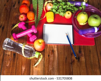 Healthy eating ,Workout and fitness dieting ,fitness and weight loss concept, fruit, Vegetable ,herbs, water bottle,speed rope, blank copy space notebook,on old table wooden background