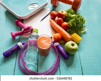 Healthy eating ,Workout and fitness dieting ,fitness and weight loss concept, fruit, Vegetable and water bottle,weight scale,on wooden background