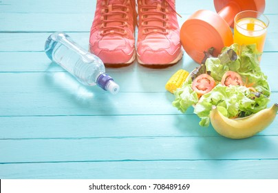 Healthy eating with Workout and fitness dieting ,fitness and weight loss concept, fruit, Vegetable and orange juice,notebook,top view on blue wooden background, Food and health.