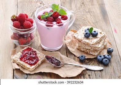 Healthy eating.Breakfast. Yogurt and berries blueberries and raspberries, slices with jam.