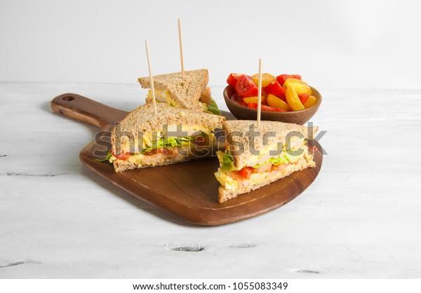 Healthy egg, tomato, lettuce and shrimp wholemeal sandwich