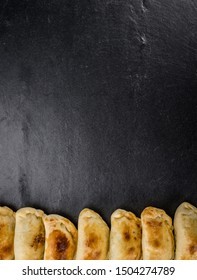 Healthy Empanadas on a vintage slate slab (close-up shot; selective focus)