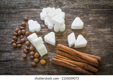 healthy energy components for humans, top view of sugar cubes, coffee beans and cinnamon sticks