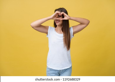 Healthy Eyes And Vision. Portrait Of Beautiful Happy Woman Holding Heart Shaped Hands Near Eyes. Closeup Of Smiling Girl With Healthy Skin Showing Love Sign. Eyecare. High Resolution Image.
