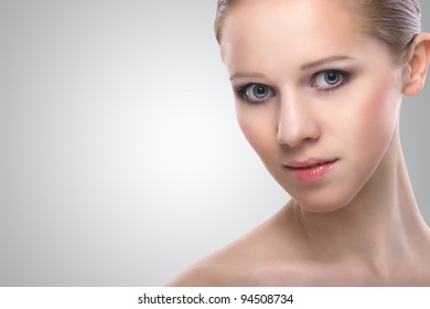 healthy face of beauty  young woman on a gray background