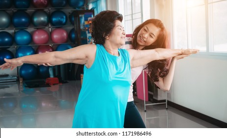 Healthy. family. Daughter help senior mother exercise.Concept of health of the senior.