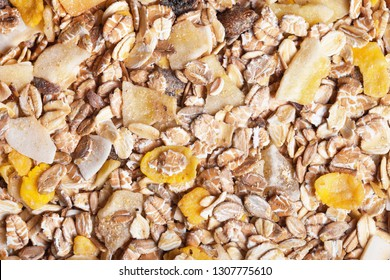 Healthy fat reduction diet studio background. Breakfast oat flakes with mix of dry fruits closeup pattern.