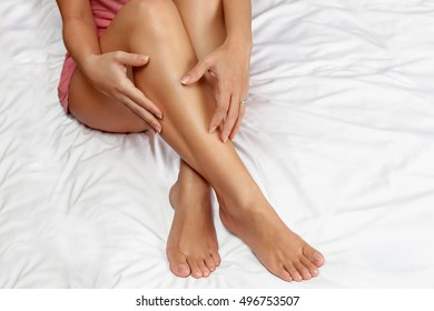 Healthy female legs, nourished and smooth skin on womans legs