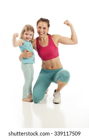 Healthy fit mom and child flexing on white studio background