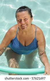 Healthy, fit older woman exercising in the pool