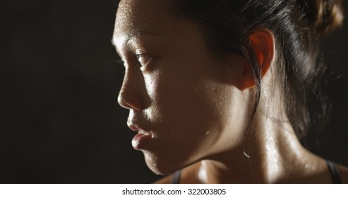 Healthy fit woman sweating taking a break from exercise