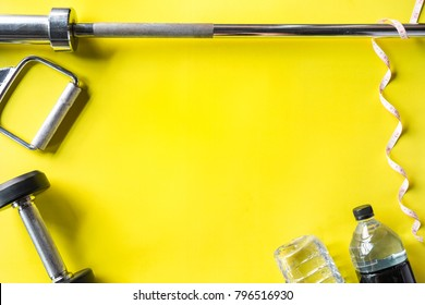 Healthy fitness lifestyle with Gym equipment on bright yellow background.
