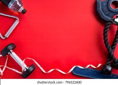 Healthy Fitness lifestyle with Gym equipment on red background.