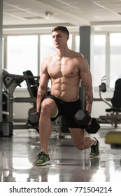 Healthy Fitness Man Working Out Legs With Dumbbells In A Gym - Front Squat Exercise