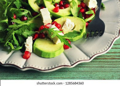 Healthy fitness salad with arugula, avocado, feta . Vegetarian nutritious salad. Keto diet. Keto lunch idea recipe.