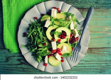Healthy fitness salad with arugula, avocado, feta . Vegetarian nutritious salad. Keto diet. Keto lunch idea recipe.