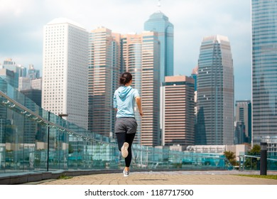 Healthy fitness woman running in the city