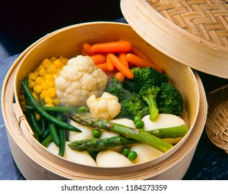 Healthy food. Assorted vegetables cooking in bamboo steamer.