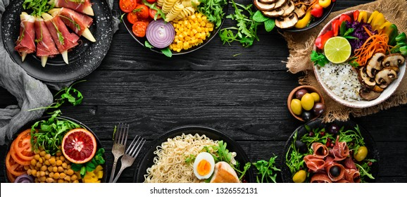 Healthy food. Assortment of the Buddha Bowl on a black background. Top view. Free space for your text.